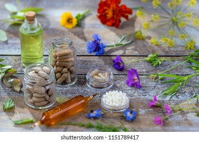 alternative herb medicine. herbal vitamin and food  supplement on wooden board