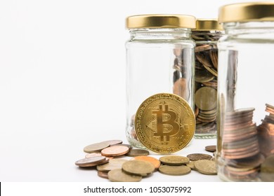 Alternative investment in bit coin. It the popular digital Crypto currency Exchange   to make capital value.  Investor may learn saving money from coins.  In white background.