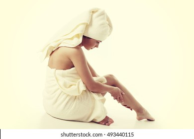 Alternative medicine and body treatment concept. Attractive  young woman after shower with towel. Instagram style