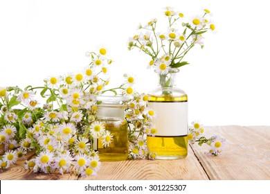 Alternative medicine concept - bottle with chamomile