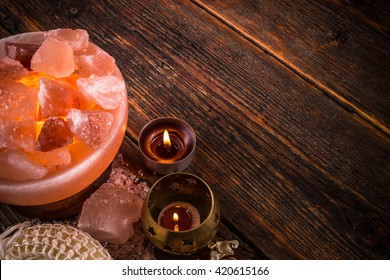 Alternative medicine concept with salt lamp and aromatherapy candle
