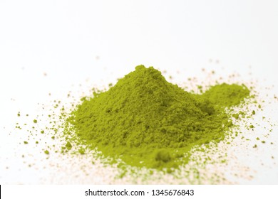 Alternative medicine, herbal pain management and opioid withdrawal treatment concept theme with a pile of green kratom powder isolated on white background