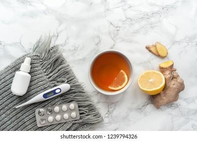 Alternative medicine. Herbal tea on table. Lemon, ginger. Top view.