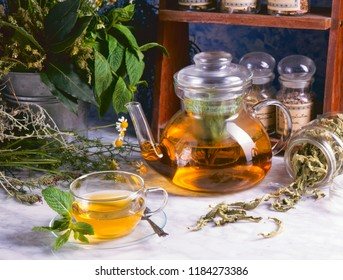 Alternative Medicine. Herbal Therapy. Cup of infusion and healing herbs.
