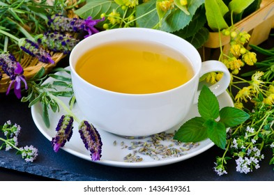 Alternative Medicine. Herbal Therapy. Infusion of healthy herbs. Black background