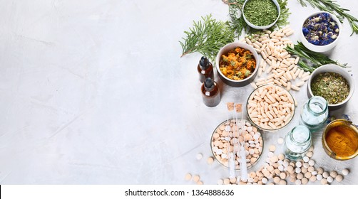 Alternative medicine herbs and homeopathic globules. Homeopathy medicine concept. Top view with copy space, Panorama, banner
