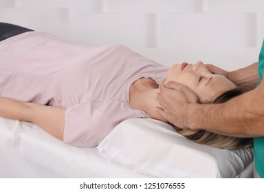 Alternative medicine and holistic health care. Woman having reiki healing treatment. Osteopathy, Physiotherapy concept