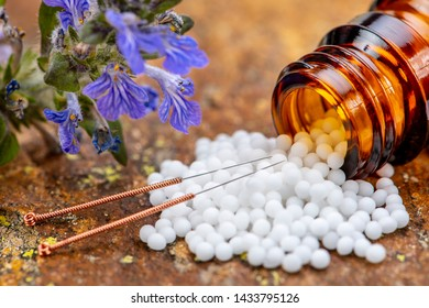 Alternative medicine with homeopathic pills and acupuncture