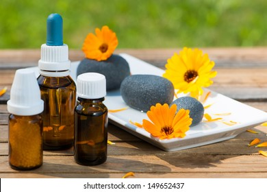 Alternative medicine with marigold flowers