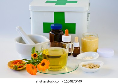 Alternative Medicine. Marigold products and first aid box in background.