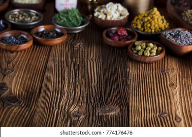 Alternative medicine. Mortar, herbs, rustic wooden table.