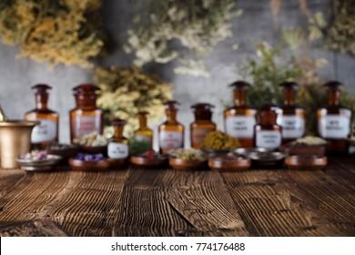 Alternative medicine. Mortar, herbs, rustic wooden table.