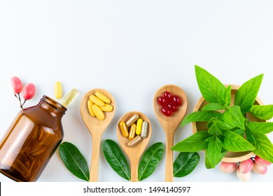 Alternative medicine, pills tablet, capsule and vitamin organic supplements good for health in wood spoon on white background with copy space, medicine and drug concept