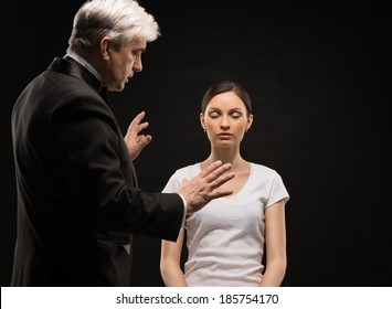 Alternative medicine therapist using hypnosis to heal his patient