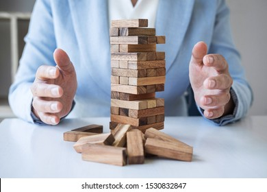 Alternative Risk and Strategy in business, Business woman's hands protect balance wooden stack with hand control risk shape hierarchy on growing to lay the foundation and development to successful.
