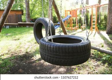 Alternative school playground with a tire swing
