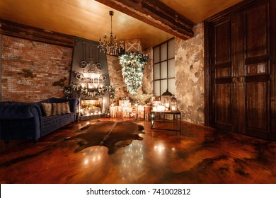 alternative tree upside down on the ceiling. Winter home decor. Christmas in loft interior against brick wall.