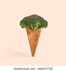 An alternative view of food. Natural icecream of broccoli on coral background. Negative space to insert your text. Modern design. Contemporary art. Creative conceptual and colorful collage.