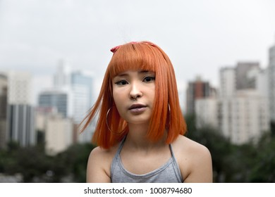 Alternative young girl with orange hair in the city
