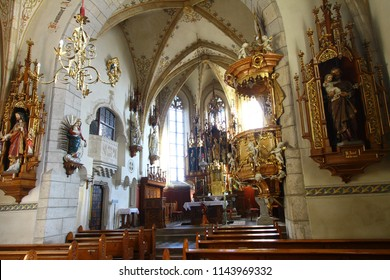 Althofen, Austria -November 27, 2015: The beautiful gilded main and some side altarswith sculptures in ancient Gothic Saint Thomas of Canterbury church (Pfarrkirche Heiliger Thomas).