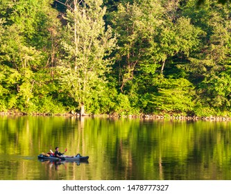 Althom, Pennsylvania, USA 8/10/2019 A lone kayaker on the Allegheny river in Warren county on a summer day