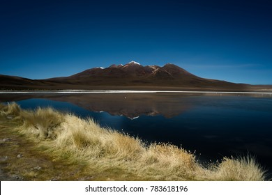 Altiplano lagoon scenery of during dessert crossing with a 4x4  in Uyuni Salt Flats in Bolivia.