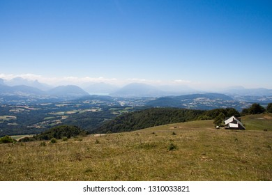 Altitude Panorama over Annecy Lake and French  Haute Savoie Valley with Barn on a Sunny Summer Day