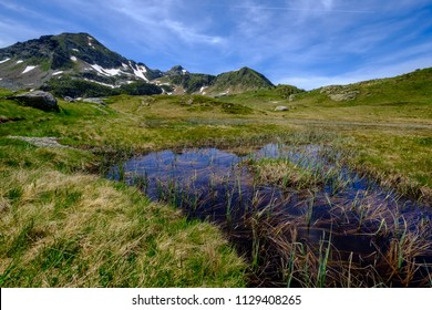 Altitude pond in early summer in the french pyrenees mountains, Ariege