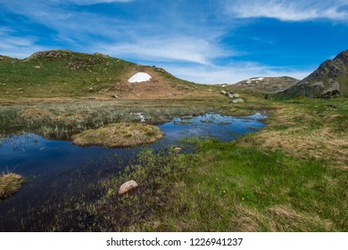 Altitude pond in summer in the french pyrenees mountains, Ariege
