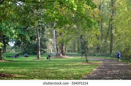 Alton Baker Park in Eugene Oregon provides a beautiful exercise environment for a lone jogger and bicycle rider.