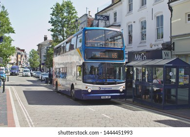 Alton, Hampshire / UK - June 27 2019: A Stagecoach bus is parked in bus stop situated in Alton High Street, waiting for passengers to board.