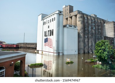 Alton, Illinois, USA, may 2019 - Looking down on Mississippi River flooding downtown Alton Broadway Street and Conagra grain silos with American flag and Welcome to Alton painted on silos