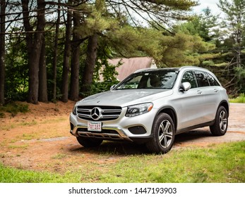 Alton, NH - June 10 2019: Silver Mercedes GLC parked in a driveway.