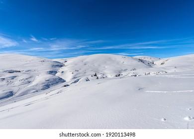 Altopiano della Lessinia (Lessinia Plateau) in winter with snow and Monte Tomba (Tomb Mountain), Regional Natural Park, near Malga San Giorgio, ski resort in Verona province, Veneto, Italy, Europe.