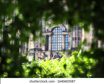 Altstadt, Bruhl Terrace park, view of the istoric building and sculptures through tree branches, Dresden, Germany