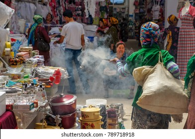 ALTYN ASYR BAZAAR, ASHGABAT, TURKMENISTAN – MAY 31, 2013 : Insect repellent with smoke at Altyn Asyr bazaar also known as Taze Jygyldyk or New Tolkuchka the largest open air market in Central Asia.