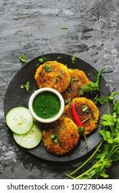 Alu ki Tikki / Indian snack Potato (Aloo)  Patties served with cilantro chutney