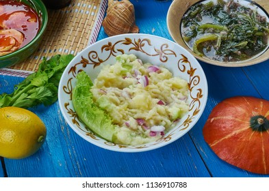 Alu Pitika, Mashed Potato in Mustard Oil , Assamese cuisine South-East Asia Traditional assorted dishes, Top view.