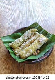 Alu-Alu cake is a traditional snack in Tegal and its surroundings. A cake made from real sticky rice wrapped in banana leaves like rice cake, served with grated coconut and a little salt.