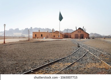 Al-Ula, Saudi Arabia, September 23, 2018: Saudi flag flies over the renovated barracks and train station with ancient Madaen Saleh's location at the background.