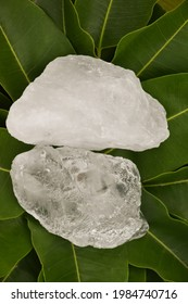Alum cubes on leaves background, concept for herb, bodycare, skincare, waterclear and protect armpit smell.