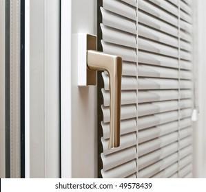 Aluminium blinds on the plastik window