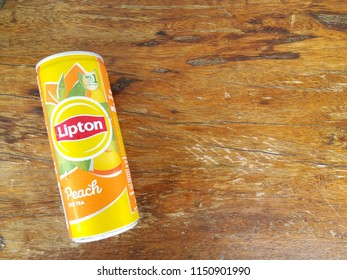 aluminium can of Lipton ice tea with peach in top view on wood table background, July, 2018, Chiang mai, Thailand