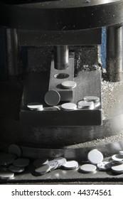 Aluminium circles on a press machine