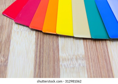 aluminium composite panel colours   chart  on a wooden surface.