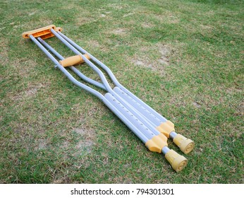 The aluminium of crutches for supporter the broken legs patient on the green grass field