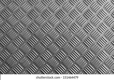 Aluminium dark list with rhombus shapes.
