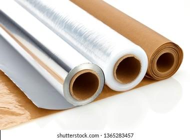 aluminium foil baking paper and plastic film on white background