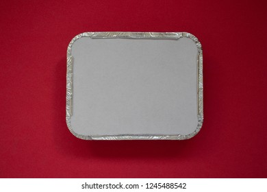 Aluminium foil container on a red background