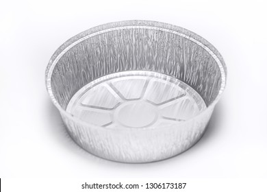 Aluminium foil heat resistant container for cooking food or storage products isolated on white background. Takeaway service. Horizontal color photography.